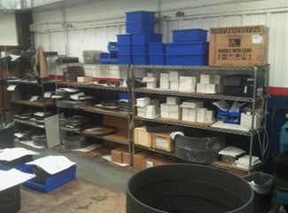 Shelves inside HCA-TX's shipping department before continuous improvement activity …