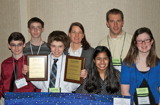 Team Santos from Woodside Middle School in Fort Wayne, Ind., won the Excellence in Systems Integration Award at the Future City National Finals. Team members are Matthew Fisher (from left), Skip Jester, Tyler Kuntz, teacher mentor Laura Smith, Ameena Sohail, engineer mentor Troy Larkins and Jodi Camino.
