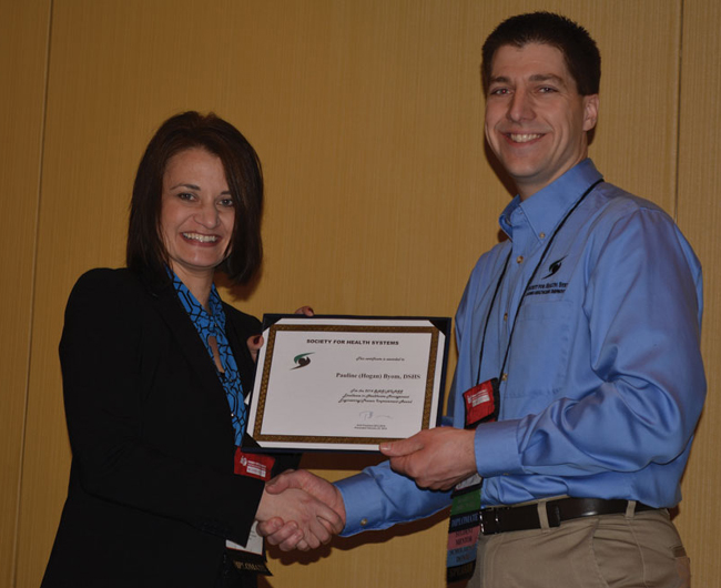 Pauline Byom (left) receives the 2014 SHS/HIMSS Excellence in Healthcare Management Engineering/Process Improvement Award from SHS Immediate Past President Todd Schneider.