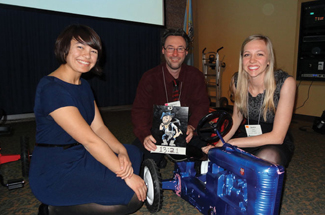 South Dakota School of Mines and Technology students Andrea Marie-Babbs (from left), Matthew Walter and Jessica Shull pose with the tractor they built for a kaizen competition at the North Central Region University Conference. Walter holds the placard with the team's preliminary time.