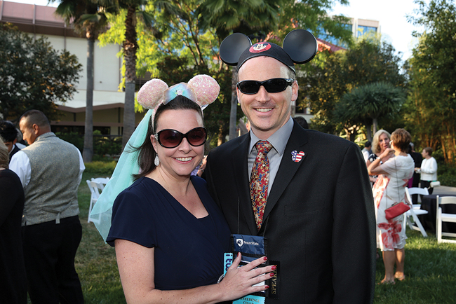 Sean Genovese of Boeing and his wife, Jennifer, show off their ears at the President's Reception on May 23.