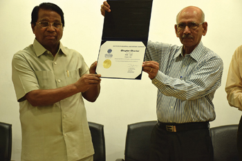 VIT University Chancellor G. Viswanathan (left) and K.R. Anandakumar Nair hold the inaugural chapter charter for IISE-VIT.