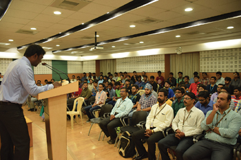 Faculty coordinator Vijaya Kumar Manupati addresses faculty and students during the inauguration of IISE's first university chapter in India at VIT University in Vellore, India.