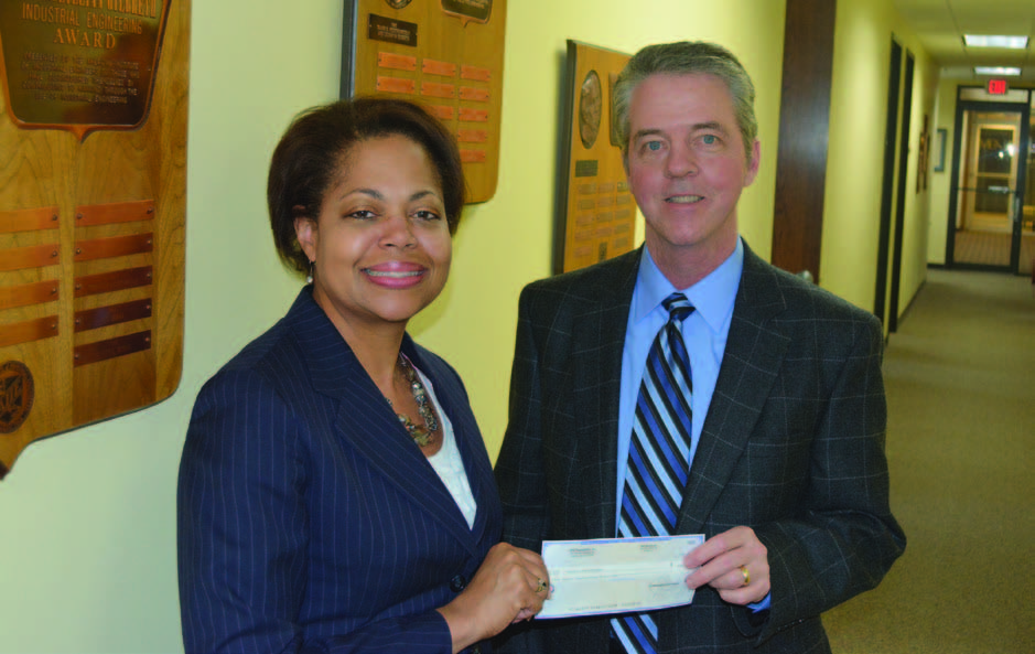 The UPS Foundation has funded female and minority awards and scholarships to IIE for years. Here, UPS' Kelli Franklin-Joyner (left) hands a $15,350 check to IIE's Don Greene.