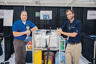 Operations manager Jonathan Edwards (left) and industrial engineer Chris Knieriem show off a cart Gulfstream employees devised to help bring the work to the workers.