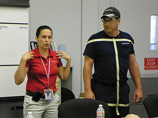 Gulfstream's Davana Pilczuk (left) uses masking tape to
