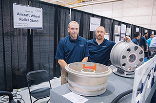 Kyle Pihlstrom (left) and Dan Cuff display the modified motorcycle wheel stand