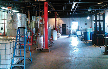 The distillery interior includes large stills, Dr. Crow and Rumsfield, which